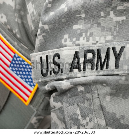 US Army and flag patch on military uniform - close up shot - stock photo
