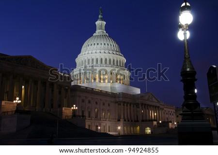 US Capitol building at dusk, street lights, Washington DC. - Eastern facade - stock photo