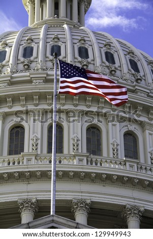 US Capitol Building Dome, Washington DC, with American Flag. - stock photo