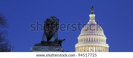 US Capitol dome and the Lion statue in front of the Capitol building,  in twilight - Washington DC USA - stock photo
