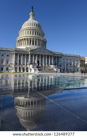 US Capitol Hill east facade and mirror reflection on stone stand - Washington DC, United States - stock photo