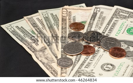 US Coin Currency on Paper Bills - stock photo