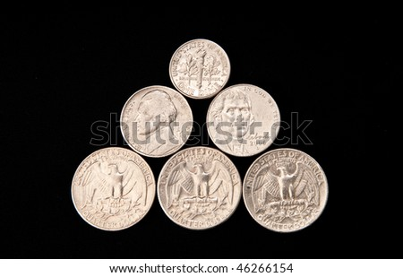 US Coin Currency Pyramid on Black - stock photo