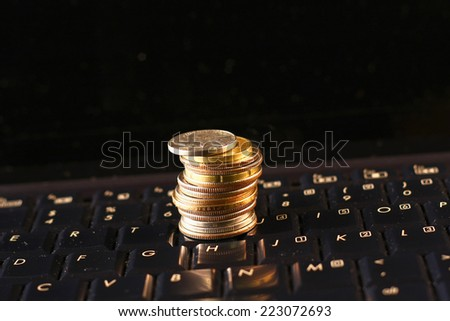 US coins on computer keyboard. Concept of e-commerce or online business. - stock photo