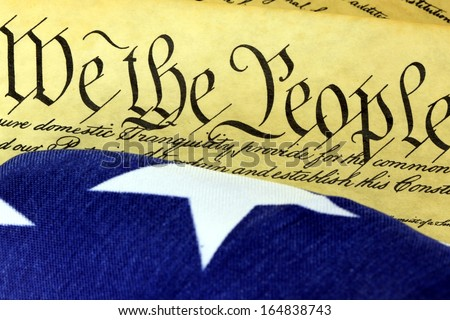 US Constitution - We The People with American Flag - stock photo