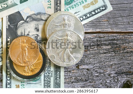 US currency, walking liberty silver, gold and paper bills - stock photo