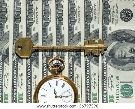 US currency, watch, key - as concept of  Financial Success - stock photo