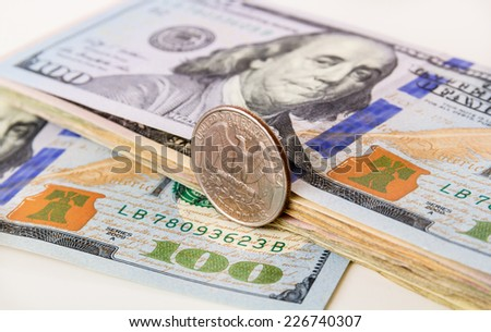 US Currency with one quarter coin - stock photo