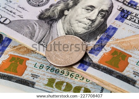 US Currency with one quarter coins - stock photo