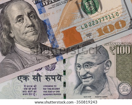 US dollar and indian rupee banknotes, currency exchange, money closeup - stock photo