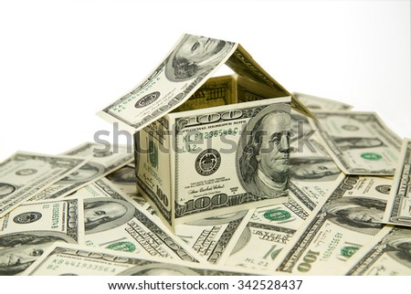 US dollar banknotes on display in the shape of a house on the expansion of the money - stock photo