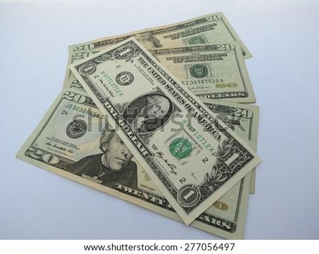 US dollar banknotes - one-dollar and twenty-dollar bills - stock photo