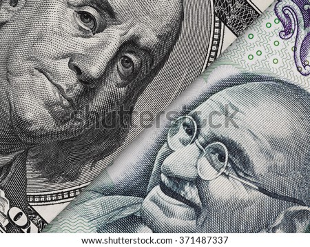 US dollar bill and India rupee banknote macro, Indian and USA economy finance trade business, money closeup - stock photo