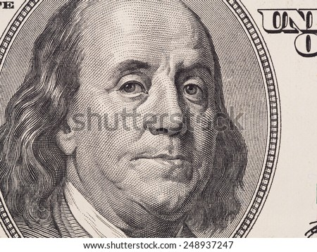 US 100 dollar bill fragment closeup, Benjamin Franklin face portrait, united states money - stock photo