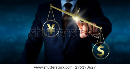 US dollar outweighing the Chinese yuan renminbi or Japanese yen on a golden scale. Torso of a trader touching a virtual balance. Theme of currency transaction in the modern foreign exchange market. - stock photo