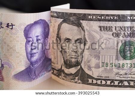 US Dollar versus Chinese Yuan - stock photo