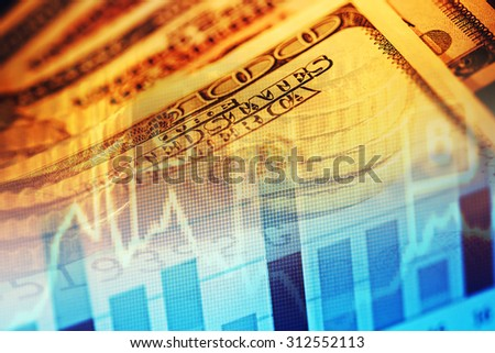 US dollars and finance graph. Macro image. - stock photo