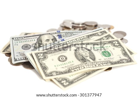 US dollars banknote and coins on white background - stock photo