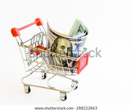 US dollars banknote in shopping cart isolated on white background. Concept of currency, business, finance and online shopping/e-commerce. Copy space. - stock photo