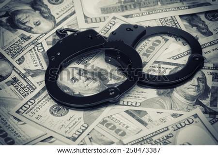 US dollars. Handcuffs on money close up - stock photo