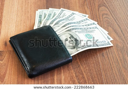 US dollars in a black wallet - stock photo