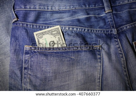 US dollars in the jeans pocket - stock photo