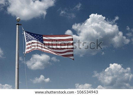 US Flag against clouds in the sky - stock photo