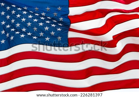 US flag in rippling with wind  - stock photo