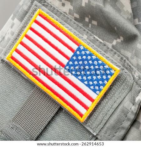 US flag shoulder patch on solder's uniform - studio shot - stock photo
