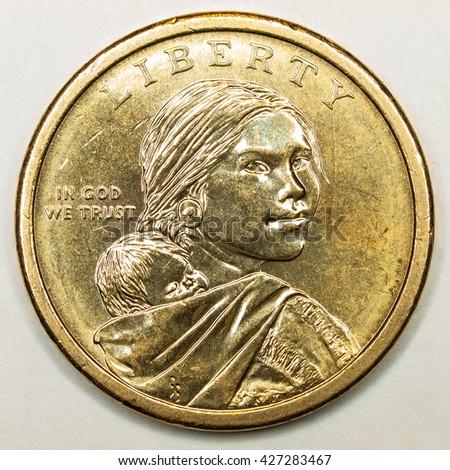 US Gold Dollar Coin Featuring Native American Sacagawea - stock photo