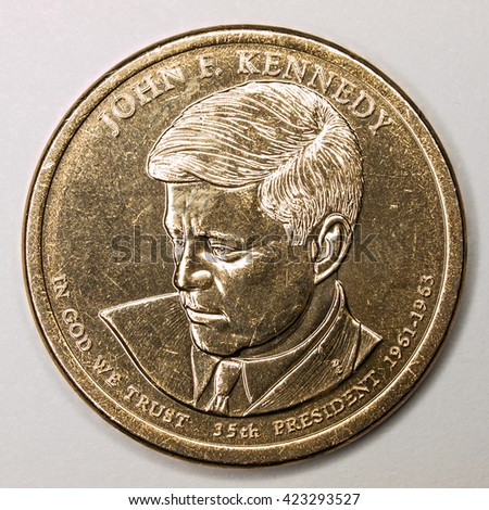 US Gold Presidential Dollar Featuring John F Kennedy - stock photo