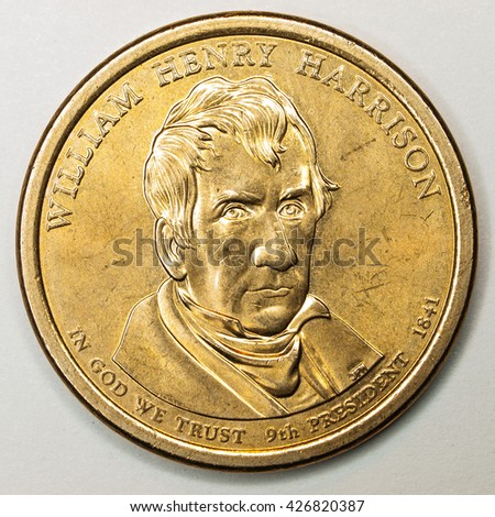 US Gold Presidential Dollar Featuring William Henry Harrison - stock photo