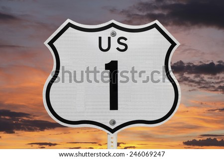 US highway one sign with sunrise sky. - stock photo