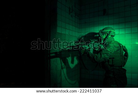 US Marine captures enemy military facility, using a night vision device. - stock photo