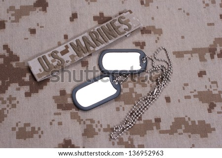 US  Marines concept with service tapes, dog tags and camouflaged uniform - stock photo