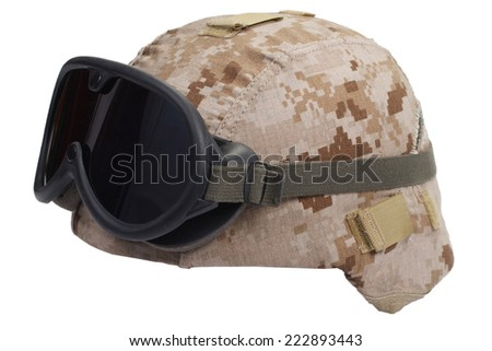 us marines kevlar helmet with desert camouflage cover and protective goggles - stock photo