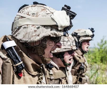 US Marines shouting at somebody showing war face - stock photo