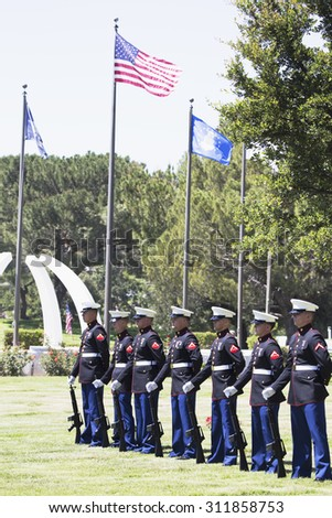 """US Marines stand at attention at Memorial Service for fallen US Soldier, PFC Zach Suarez, """"Honor Mission"""" on Highway 23, drive to Memorial Service, Westlake Village, California, USA, 06.19.2014 - stock photo"""