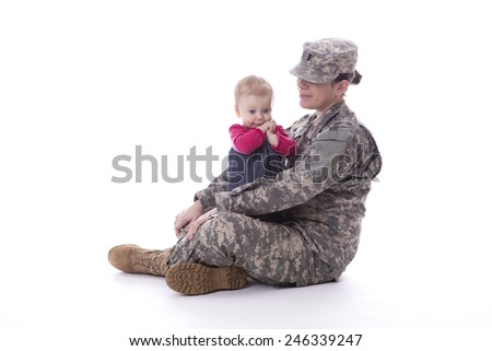 Us military mother siting and playing with her child on white background - stock photo