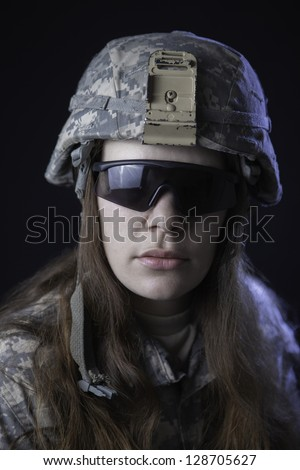 Us military woman in helmet and tactical glasses - stock photo