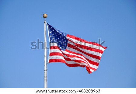US National Flag in blue sky. - stock photo