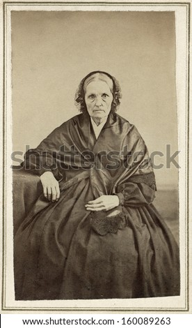 US - Ohio - CIRCA 1860 A vintage Cartes de visite photo of an elderly pioneer woman in mourning. She is dressed in a black mourning gown.  A photo from the Civil War era. CIRCA 1860  - stock photo