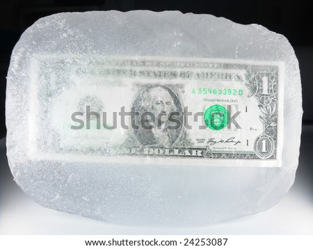 US paper currency (one dollar) frozen in ice representing a downsizing economy, financial crisis, unemployment and investment lose - stock photo