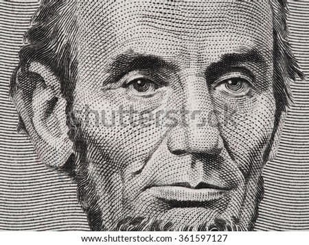 US President Abraham Lincoln face on five dollar bill macro, 5 usd, united states money closeup - stock photo