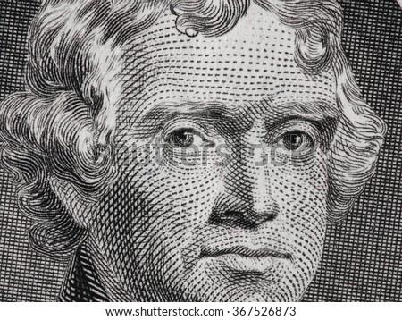 US President Thomas Jefferson portrait on us two dollar bill macro, united states money closeup - stock photo