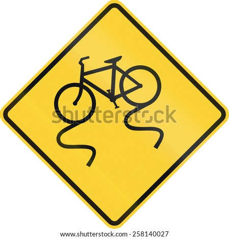 US road warning sign: Slippery when when with bicycle - stock photo