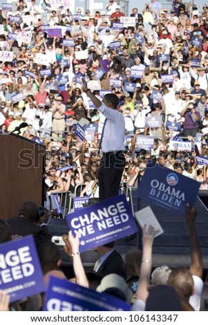 US Senator Barack Obama waving to crowd at Early Vote for Change Presidential rally, October 25, 2008 at Bonanza High School, Judy K. Cameron Stadium in Las Vegas, NV - stock photo