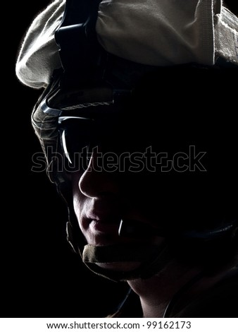 US soldier in the helmet on the black background - stock photo