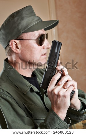 US Special Forces soldiers in uniform and with a pistol Colt - stock photo