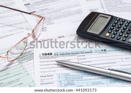 us tax form with calculator - stock photo